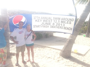 Cody and Kristin pose in front of the SAKW banner after awards ceremony.